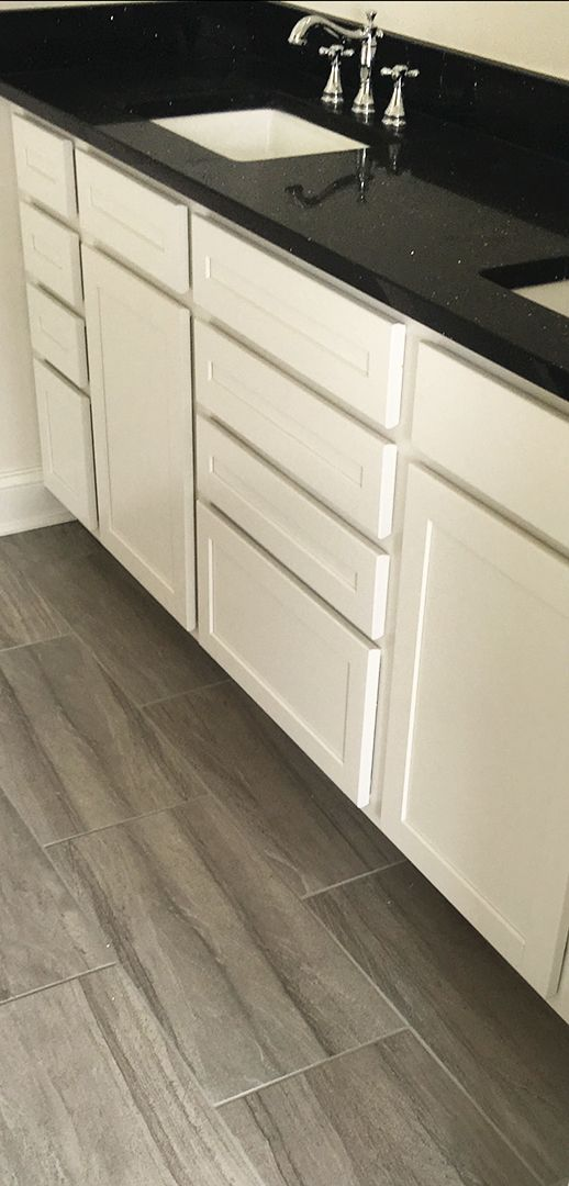 Warm Gray Large Format Floor Tile With White Cabinets And