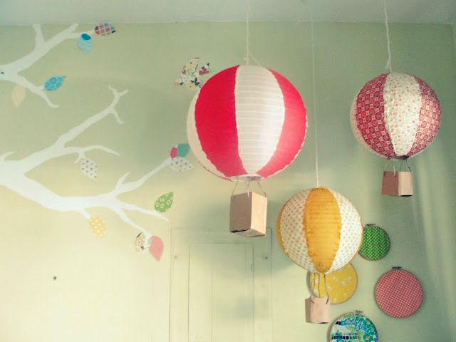 Hot air balloons made from paper lanterns. http://thejoyefuljourney.blogspot.com/2011/11/diy-paper-lantern-hot-air-balloons.html
