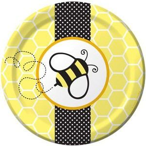 A bright yellow honeycomb background, black and white accents, and a buzzing bee create the perfect plate for dessert! ~Rosemary Company