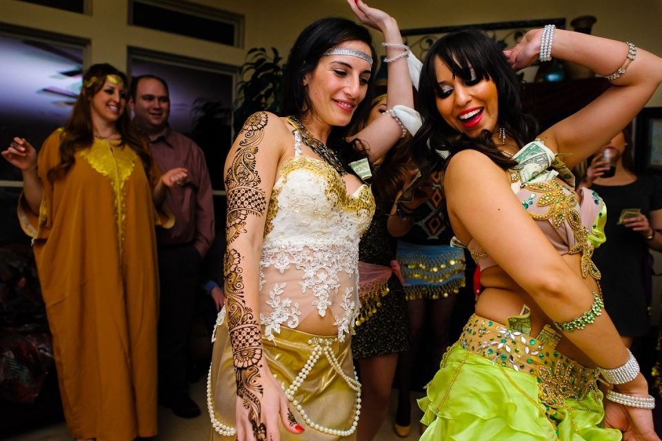 Traditional Belly Dancer Entertains The Bride Groom And Guests At