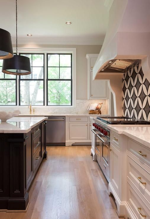 Black And White Kitchen Features White Cabinets Adorned
