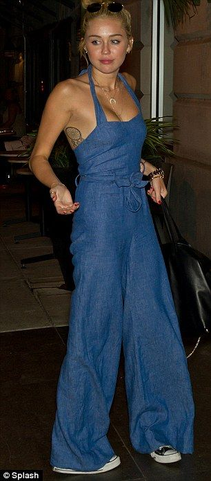 89b6cfcbc65d Denim diva  Miley Cyrus arrives back at Philadelphia hotel last night  wearing a blue halterneck