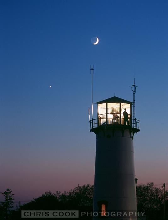 Chatham Lighthouse with thumbnail moon in background. Photo by Chris Cook, Chris Cook Photography www.cookphoto.com