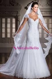 Vestidos de novia corte sirena con velo