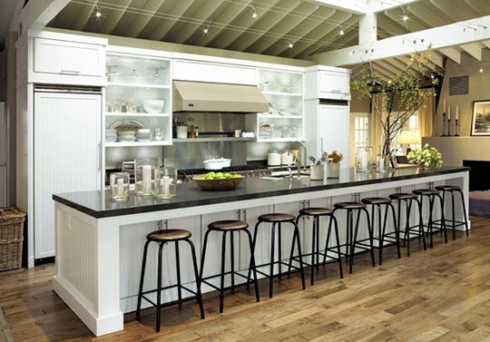 A Dramatic, Customized Island With Sink And Tasting Bar Lets The Frequent  Entertainer Enjoy Her Friends While Prepping Meals In A Highly Functional  Space.