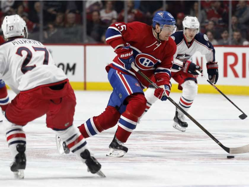 Jan.26 2016 - CBJ 5 - MTL 2 - Montreal Canadiens left wing Tomas Fleischmann looks for a chance to shoot on net as he skates between Columbus Blue Jackets defenceman Ryan Murray, left, and Columbus Blue Jackets left wing Brandon Saad during NHL action at the Bell Centre in Montreal on Tuesday January 26, 2016.