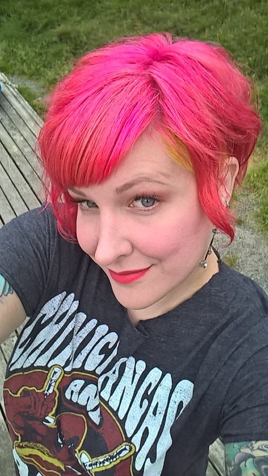 Pink hair undercut with yellow.