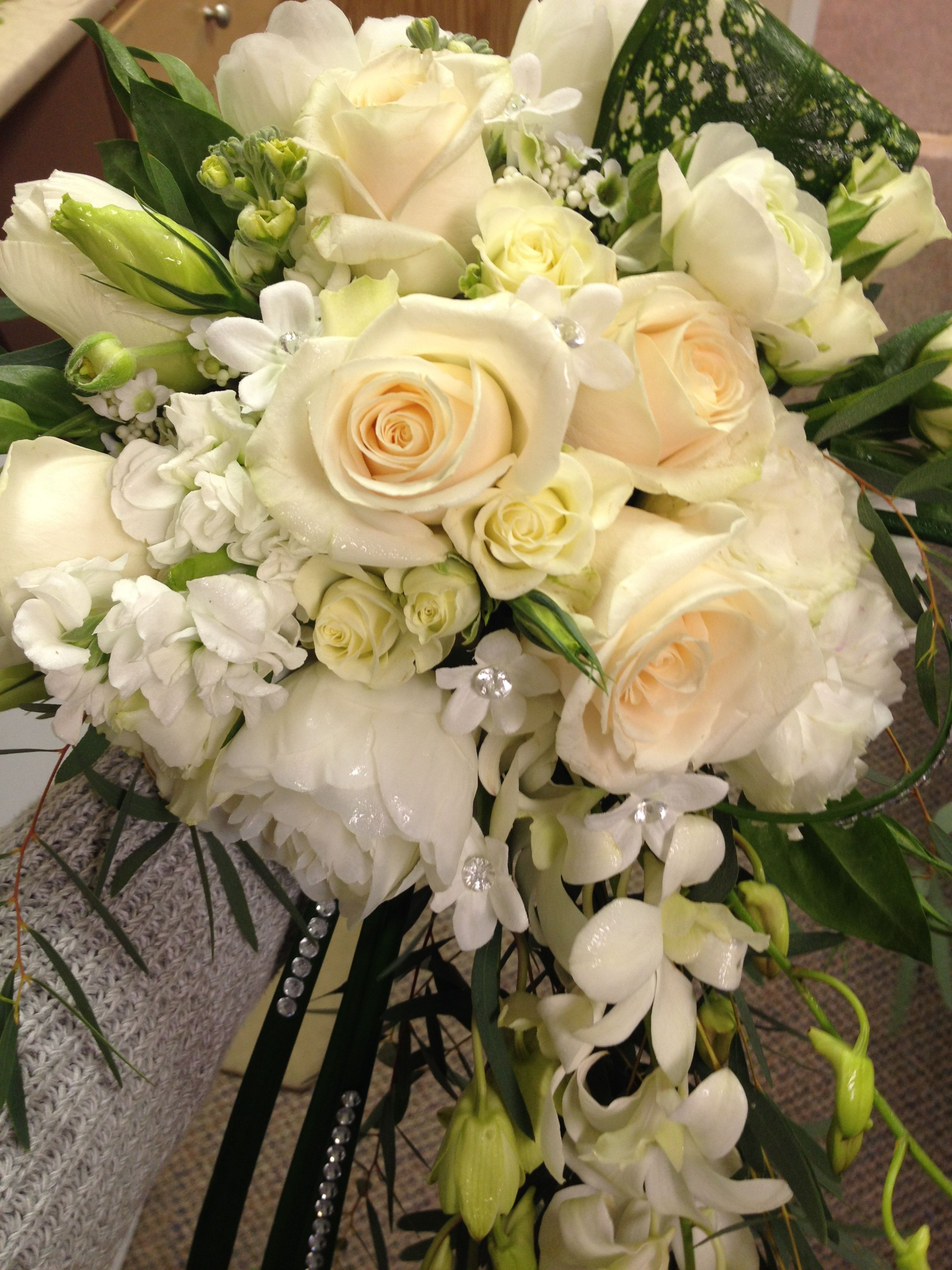 This stunning cascade bouquet features roses, peonies
