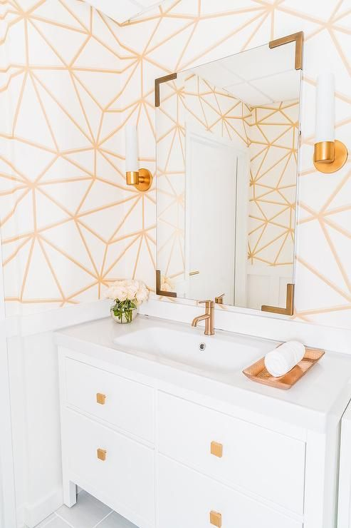 Contemporary White And Gold Powder Room Is Clad In White And Gold