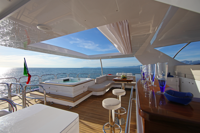 The Luxury Yacht Delfino With It S Sumptuous Sun Deck Complete With Retractable Sun Awning And Beautifully Lacquered Wood Bar Yacht Best Yachts Luxury Yachts