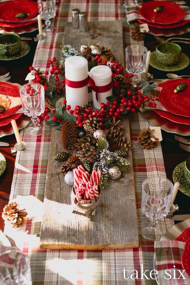 Christmas table. Love the wood plank down the center with the candles, pinecones, greenery, and peppermint sticks.