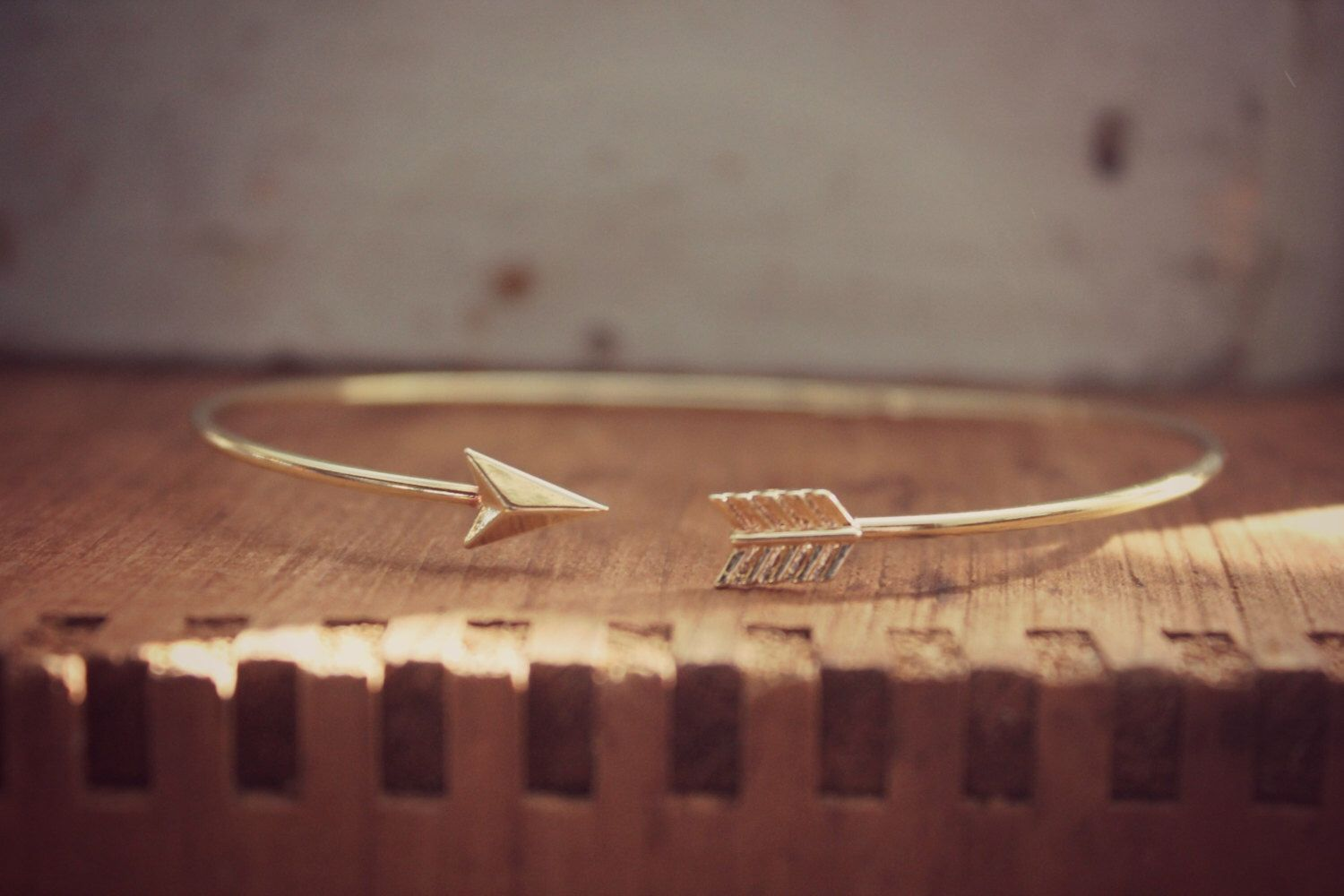 Minimalist Simple Arrow Bracelet, Gold Plated Minimialist Bracelet, Layering Bracelet, Arrow Bracelet, Stackable Bangle, Tiny Arrow by HoneyThorns on Etsy https://www.etsy.com/listing/264036073/minimalist-simple-arrow-bracelet-gold
