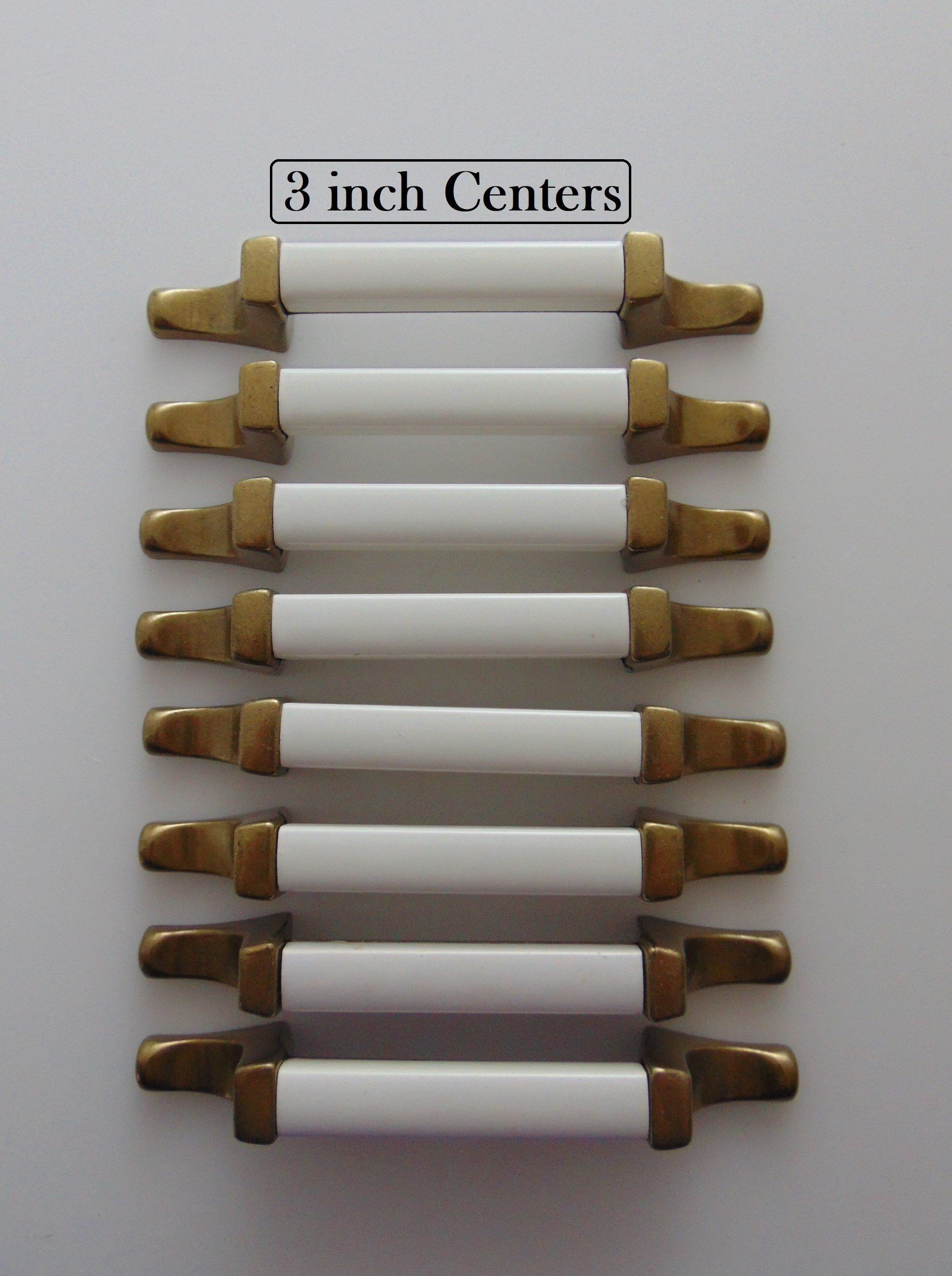 Antique brass white handles pulls 3 in centers 8