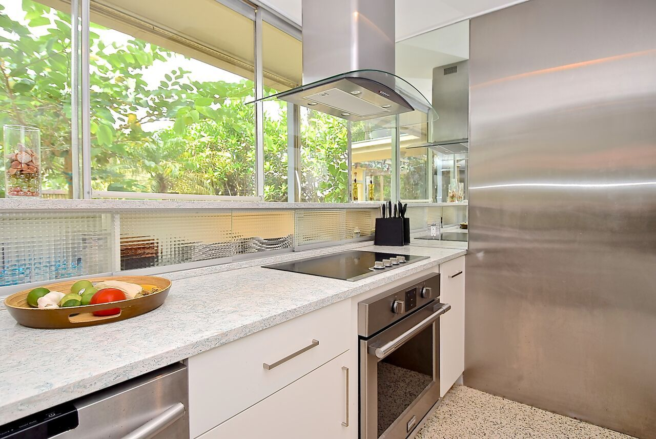 From The Giant Sliding Glass Door To The Terrazzo Floor And Modern Geometric Design This Home Is The Perfect Example Florida Design Kitchen Terrazzo Flooring
