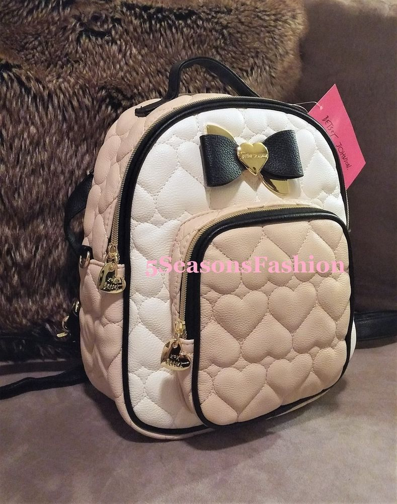 QUILTED HEARTS design. Asymmetrical black/gold tone bow. Tan and ivory color blocked scheme with black trim. Gold tone hardware, outside zipper pocket. Betsey Johnson signature liner. Hello my gorgeous fashionistas! | eBay!