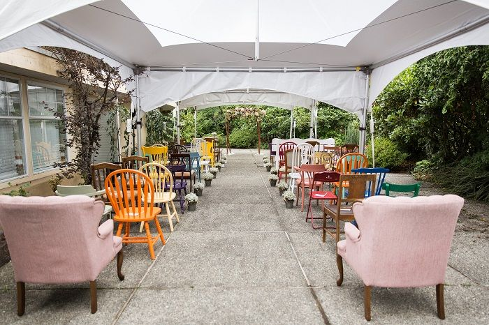 Mismatched seating - chairs and sofas gave the ceremony setting such a playful | Fab Mood #gardenwedding