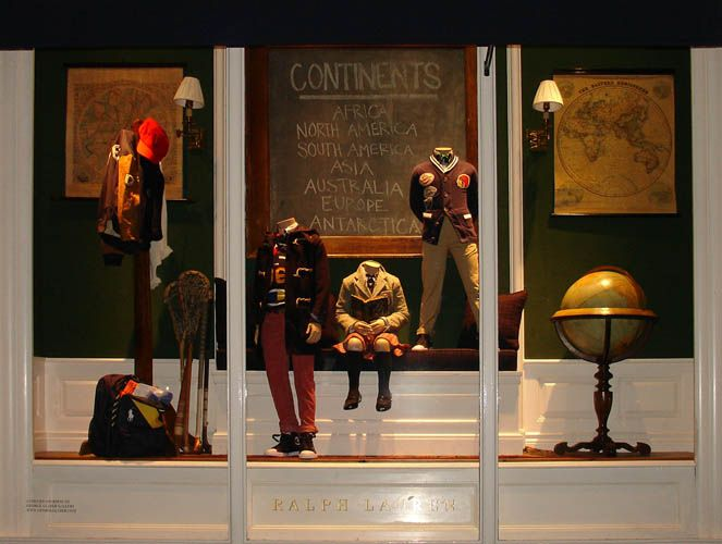 Back to school fashions were accompanied by globes, maps and a magnifying lens from the George Glazer Gallery in the Madison Avenue window of the Ralph Lauren children's store on Manhattan's Upper East Side, Aug.-Sept. 2014.