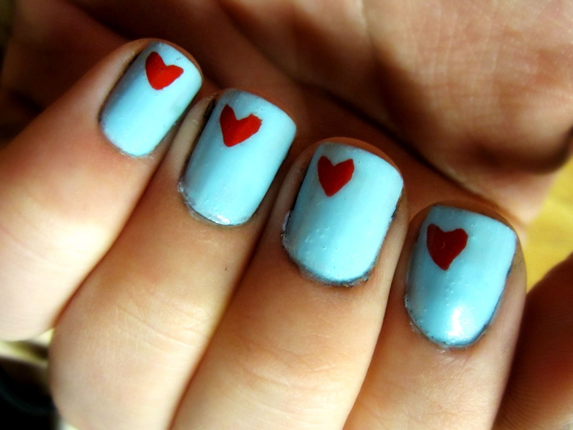 baby blue polish with red hearts <3