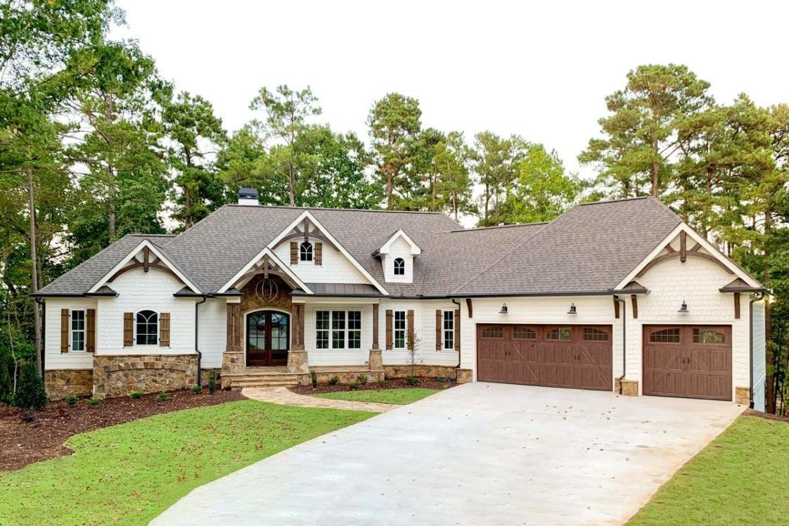 4 Bedroom Single Story Country Craftsman Home with Angled Garage and Wet Bar Floor Plan