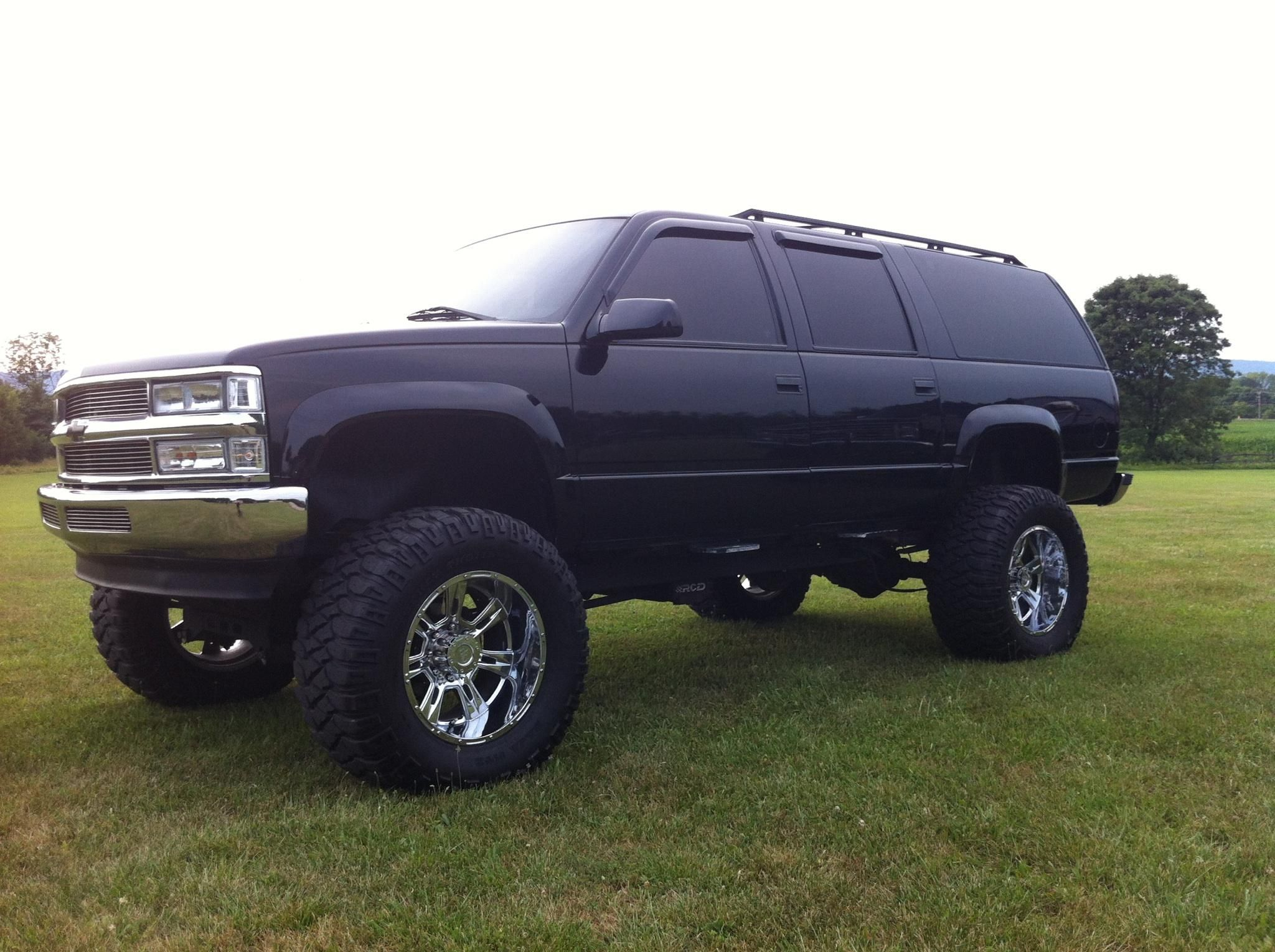 1999 K2500 Chevy Suburban 454 On 38 Mickey Thompsons Chevy Suburban Chevy Lifted Chevy Trucks
