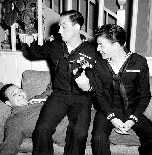 Frank Sinatra and Gene Kelly with director George Sidney on the set of Anchors…