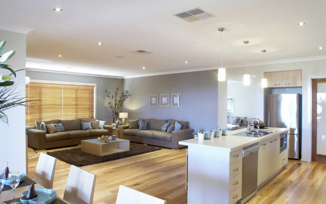 open plan kitchen dining room and living room area on timber floors
