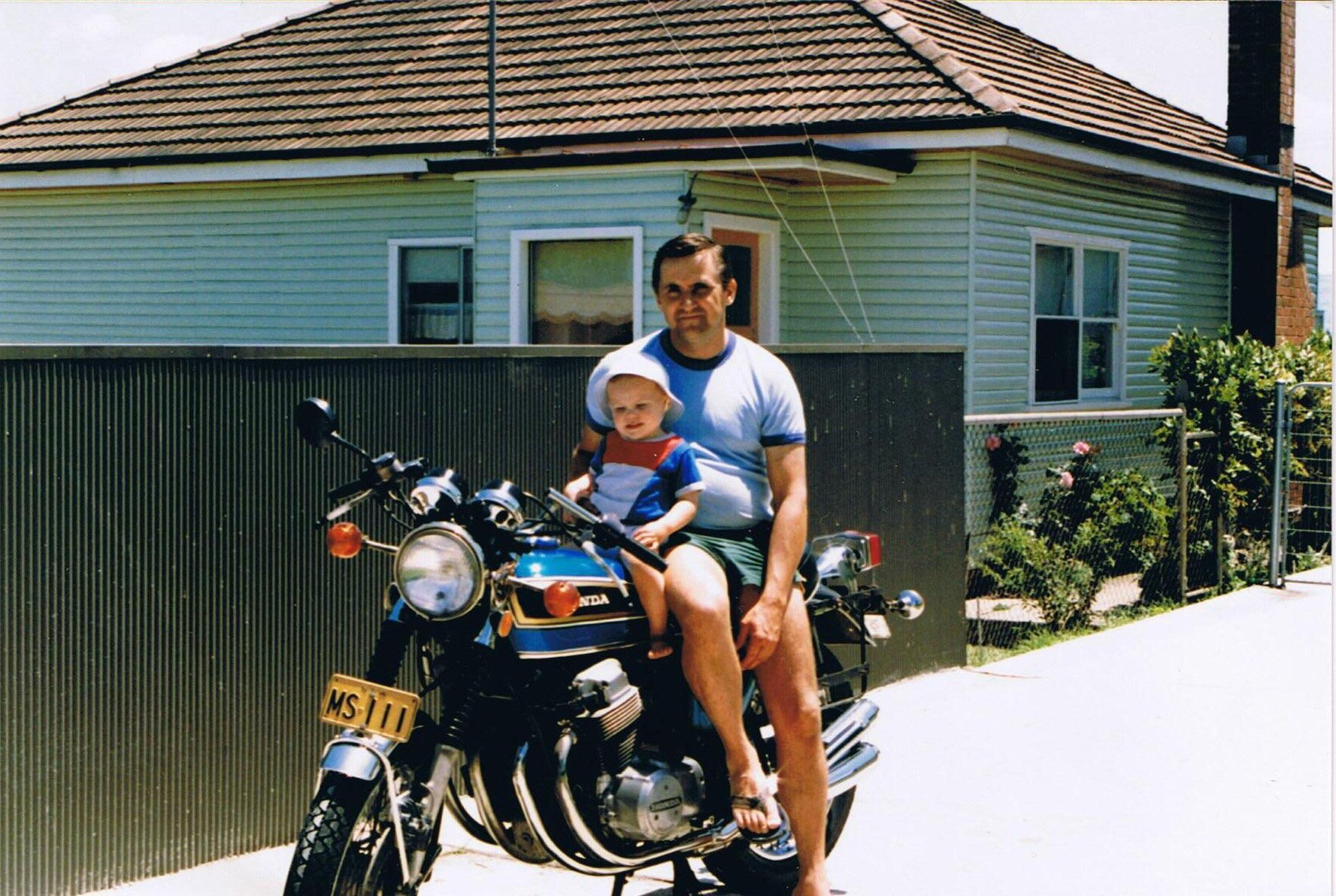 Father and son hanging out on a newish Honda cb750 [Circa 1975]