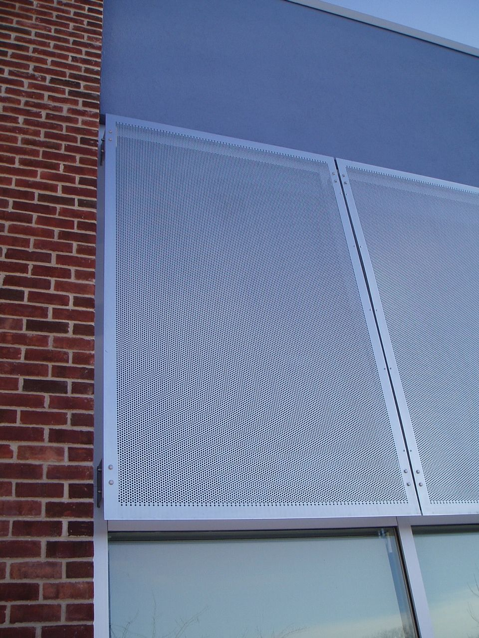 Functional And Sleek Mcnichols Perforatedmetal Panels Offer Shade As They Complement A Building S Brick Exterior