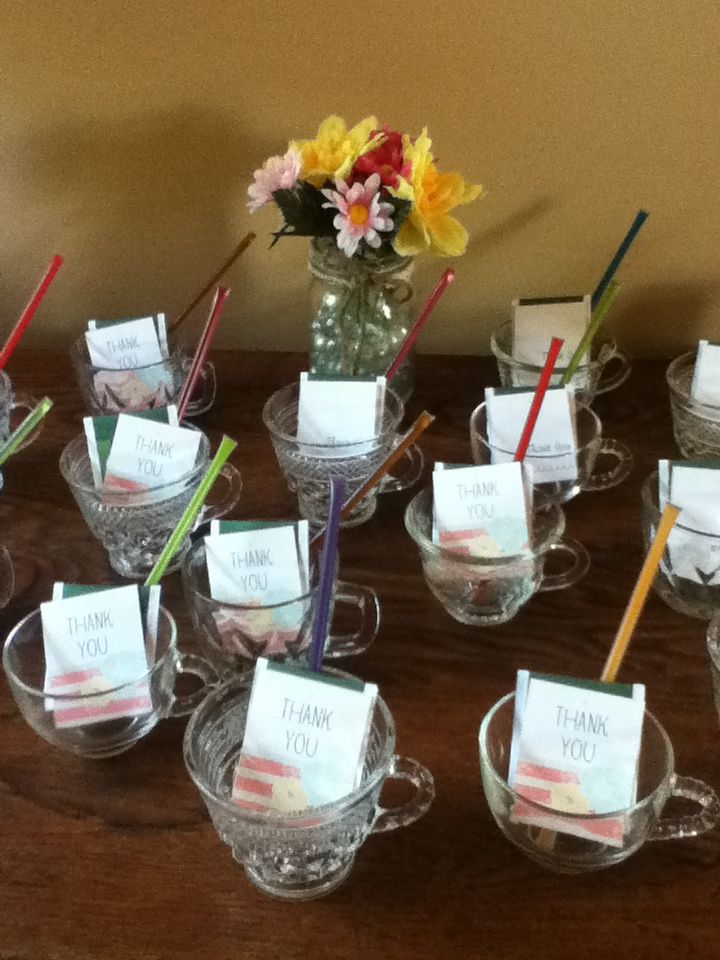 diy bridal shower favors green tea bag honey stick and thank you tag inside a glass tea cup