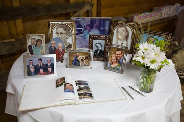love the idea of a guest book table filled with family wedding pictures