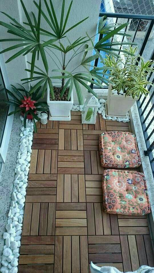 Stones to cover gaps of balcony tile. Works with white pots, but ...