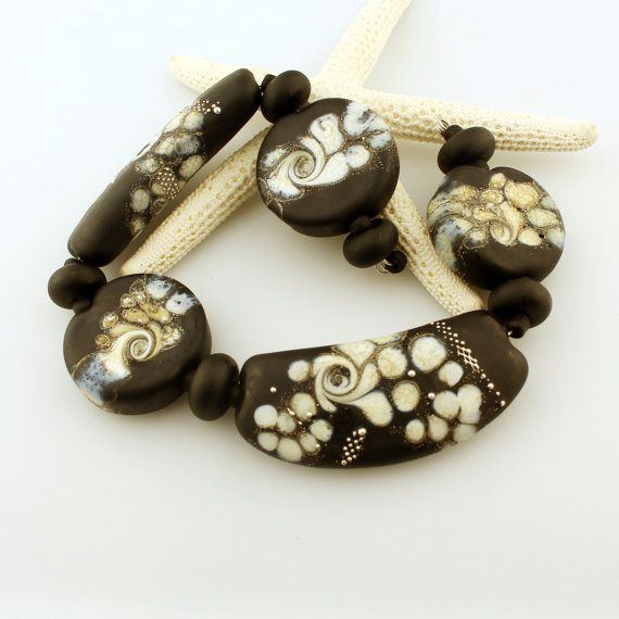 Black lampwork glass beads set for necklace bracelet and other jewelry.