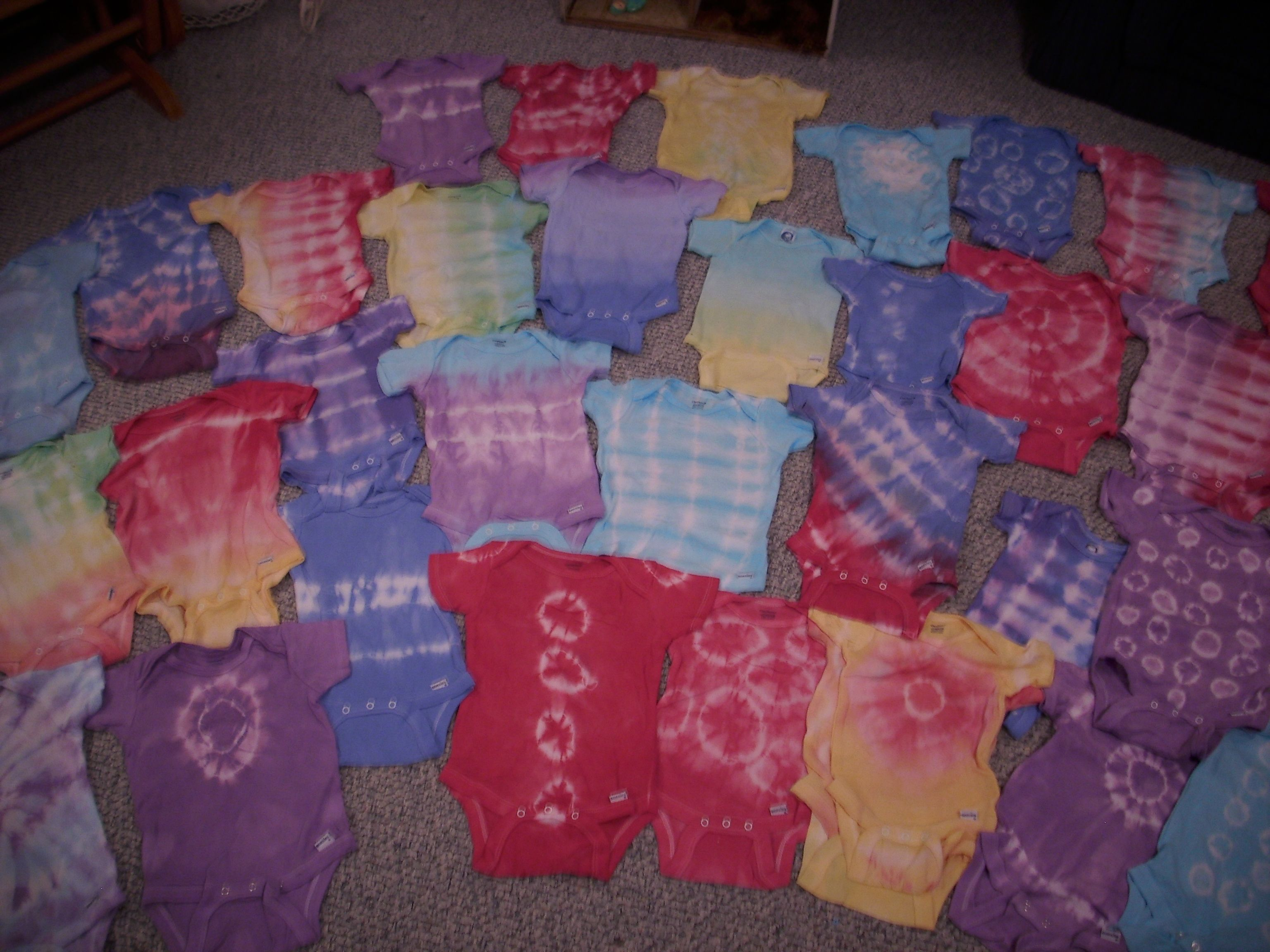 Tie-dyed baby onesies.  For your little hippie child.  All the colors of the rainbow