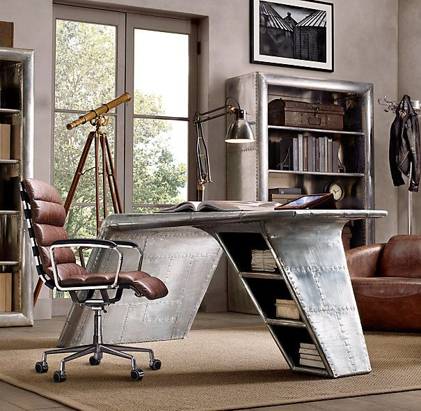 this metal desk has a slight aviation feel to it and provides a cool contrast to