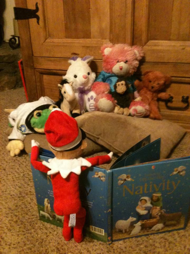Elf is reading the story of the true meaning of Christmas to some of