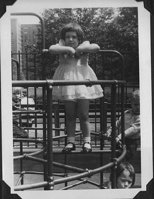 Monkey bars at the playground...yes, we wore dresses all the time, even when climbing the monkey bars