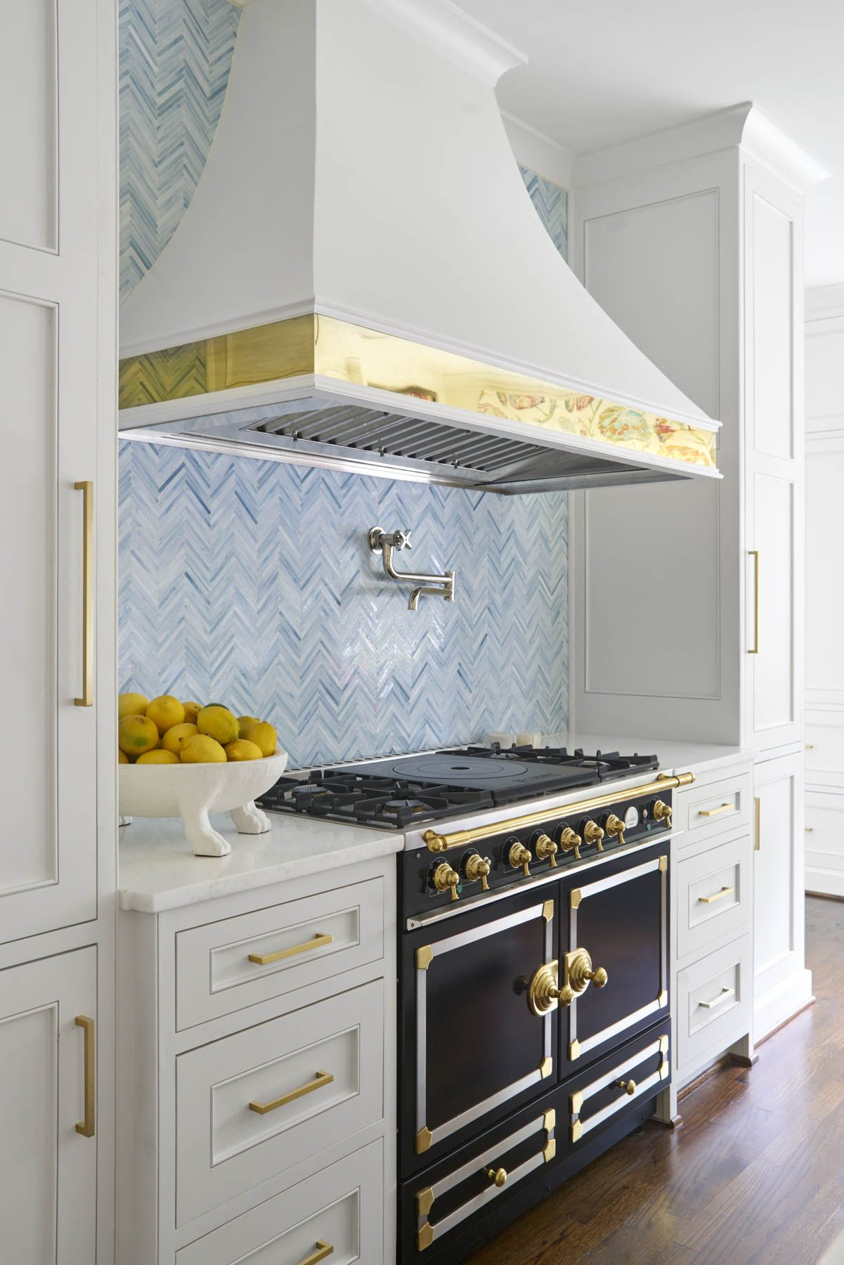 light and bright kitchen with white cabinets and brass hardware ...