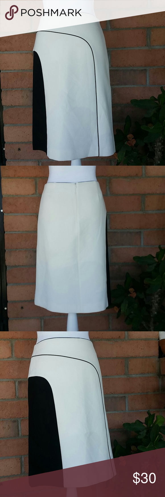"TRUCCO White/Black Color Block Skirt Euro Sz. 38 Great color block design in White/Black by TRUCCO Euro Sz. 38 ~ US Sz.   Measurements:              Waist: 28""                                         Length: 22 1/2"" TRUCCO Skirts"