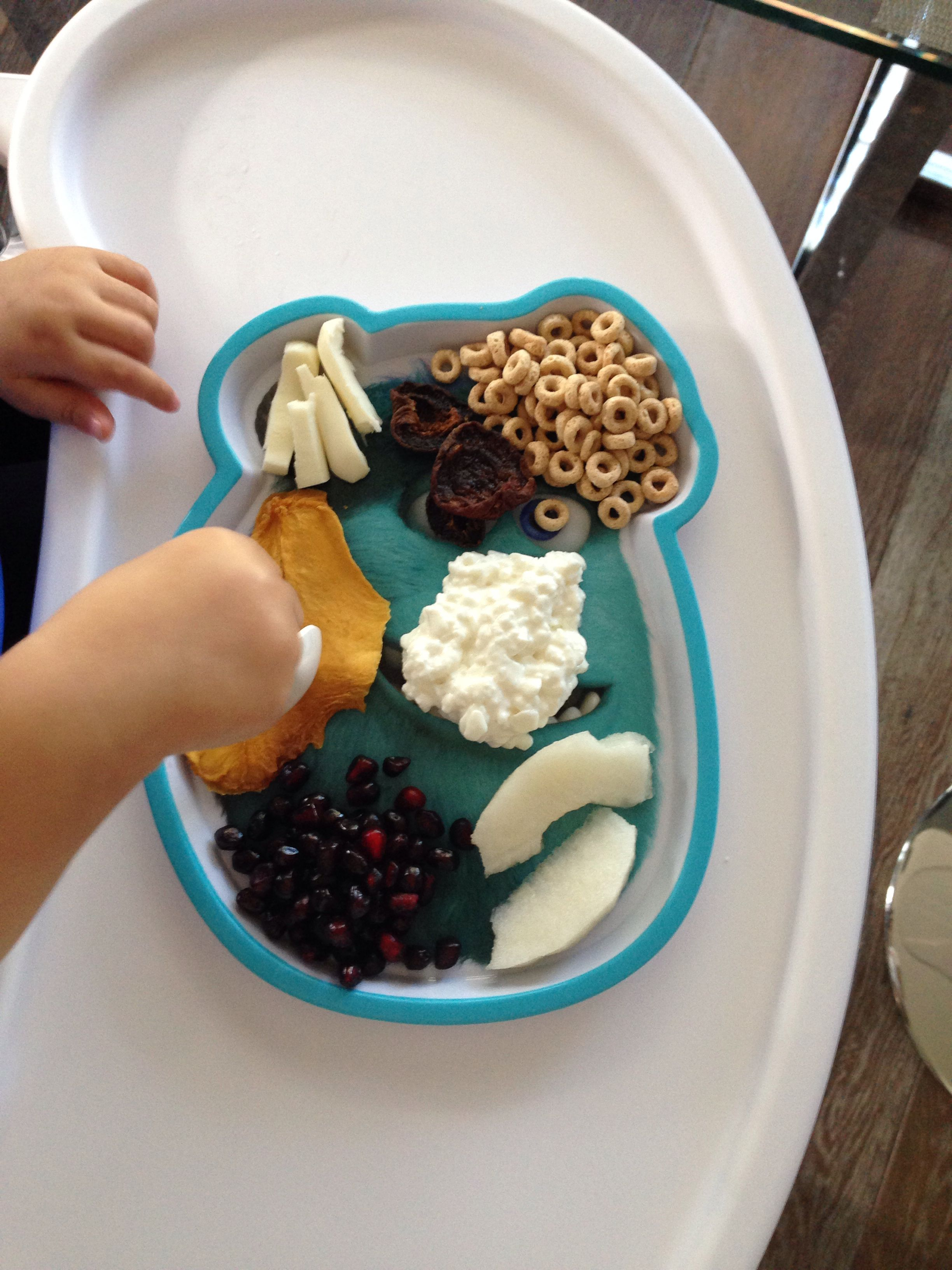 Breakfast @ 16 month old: organic dried mango, mozzarella stick, organic dried apricot, organic wholewheat cereal, organic whole cottage cheese, pears, home-grown pomegranate seeds