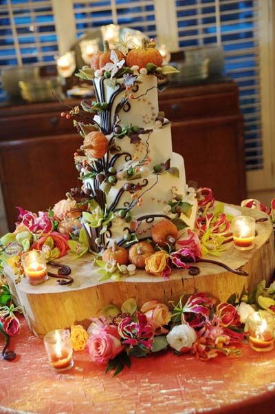 A tree trunk cake stand, mini pumpkins, and winding branches and leaves make this the quintessential fall cake.Photo Credit: Ace Photography