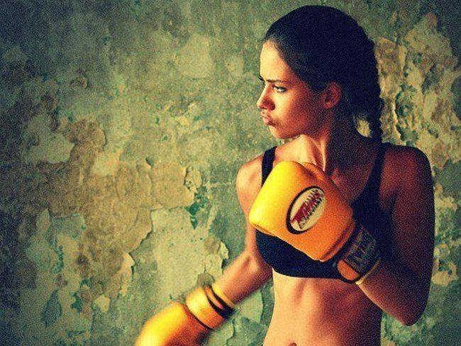 Women boxing and learning martial arts.