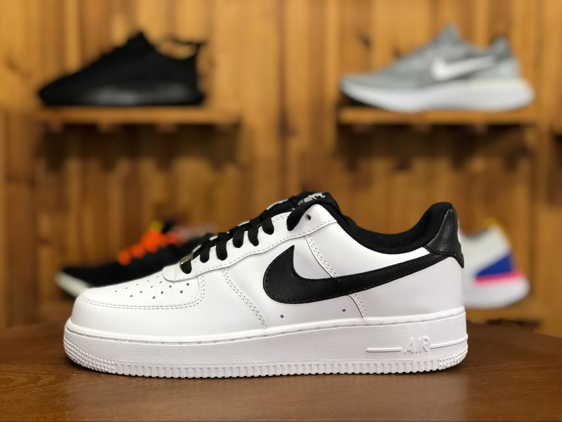 1d26a8027a4 This classic Nike Air Force 1 Low features a White leather upper with Black  detailing on the Nike Swoosh logos