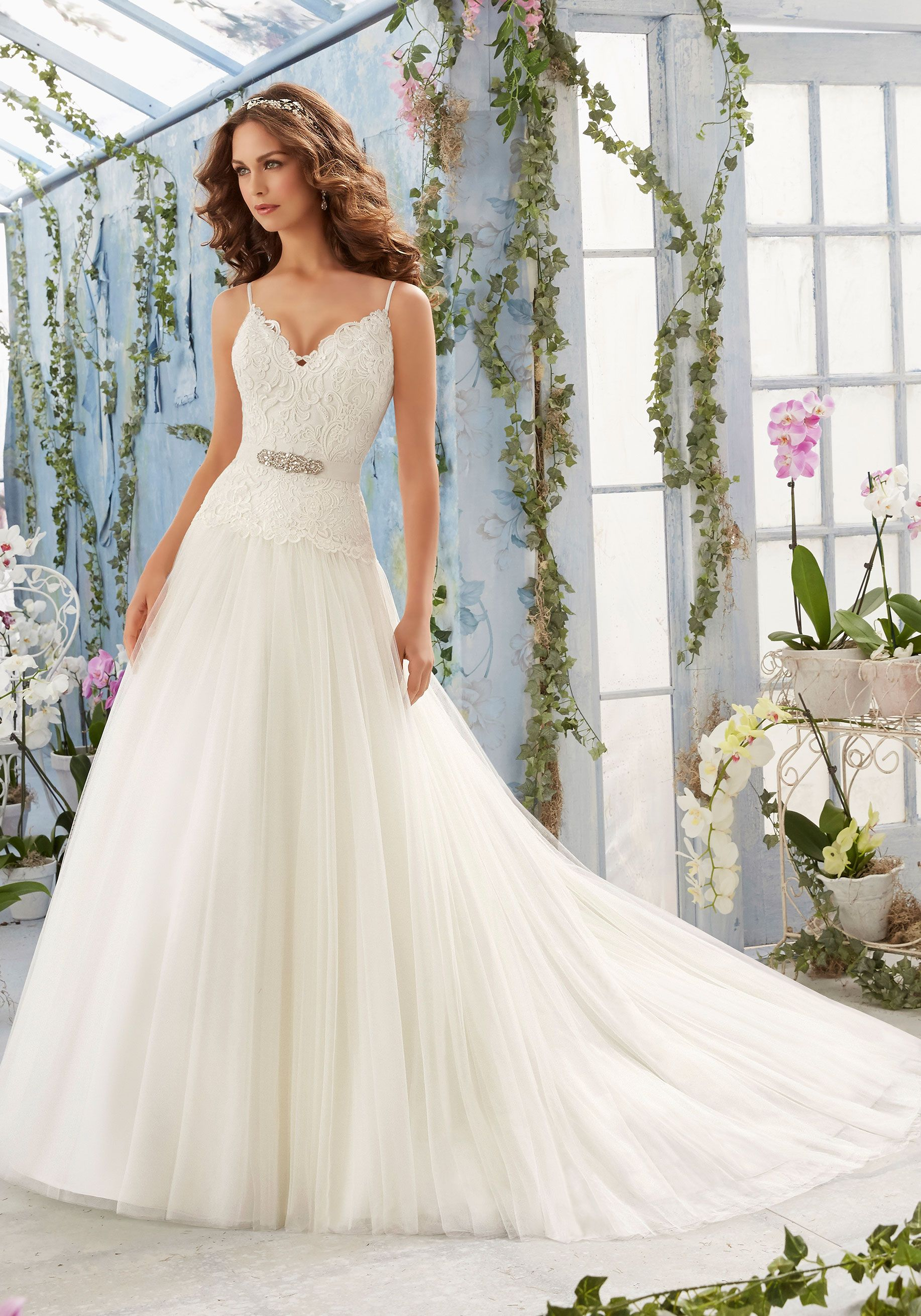 Removable beaded organza tie sash included but also the tie sash is