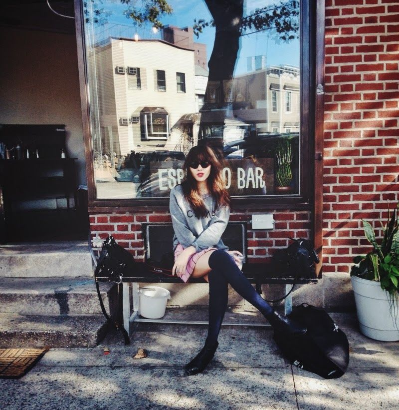 Natalie Off Duty-sweaters and thigh high socks and the street.