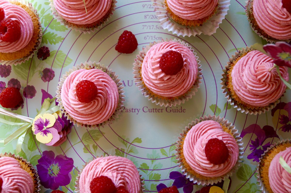 Light + perfectly buttery lemon-scented cupcakes topped with fresh raspberry buttercream. #LAGBBO I'm super excited to share thiscupcake recipe over on the Laura Ashley blog! The Great British Bak...