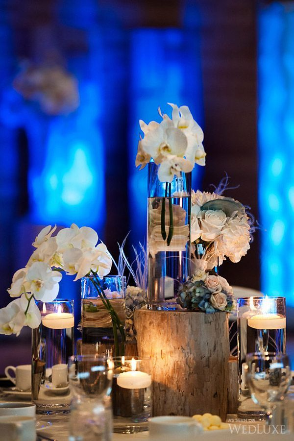 Fantastic floral decor at this uplighting wedding reception