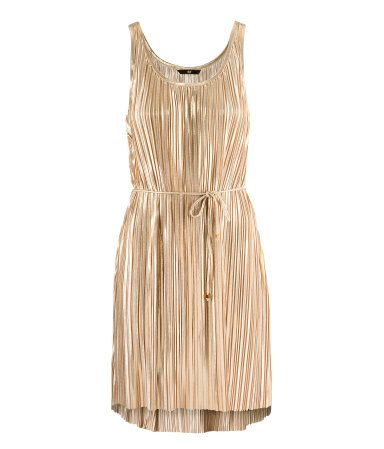 2893b5856ff1 Pleated asymmetric hem metallic dress, H and M. Knee-length dress in pleated  gold-colored jersey. Gently flared ...