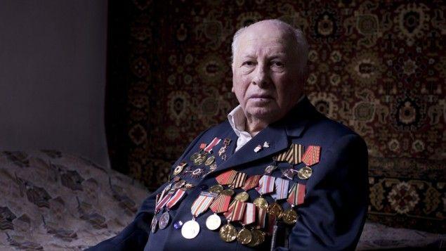 Soviet Jewish World War II veteran Matvey Gershman, 90, poses for a portrait at his house in the southern Israeli city of Ashkelon. Friday, ...