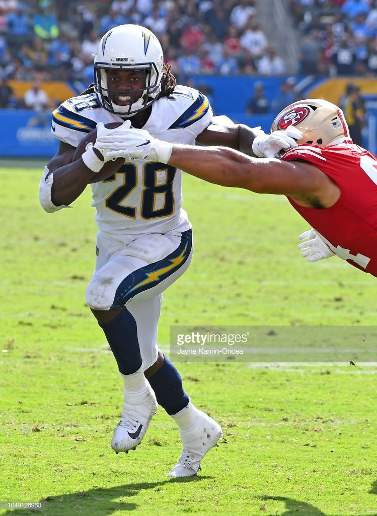 Running Back Melvin Gordon Of The Los Angeles Chargers Gets Pas Los Angeles Chargers Chargers Football Nfl Football Players