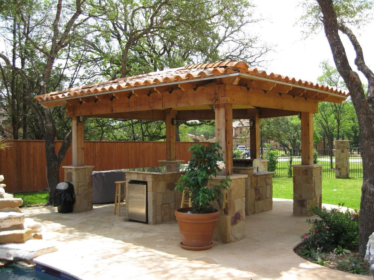 Adorable outdoor kitchen design under elegant gazebo for Outdoor kitchen pavilion designs